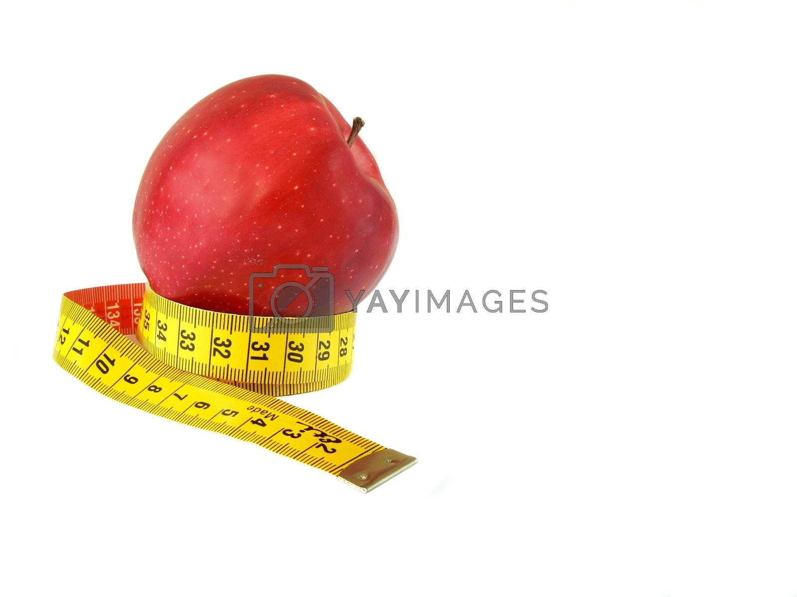 Red apple (malus) and measuring tape isolated on white