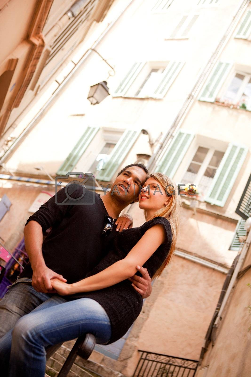 A happy french couple in a small quaint street