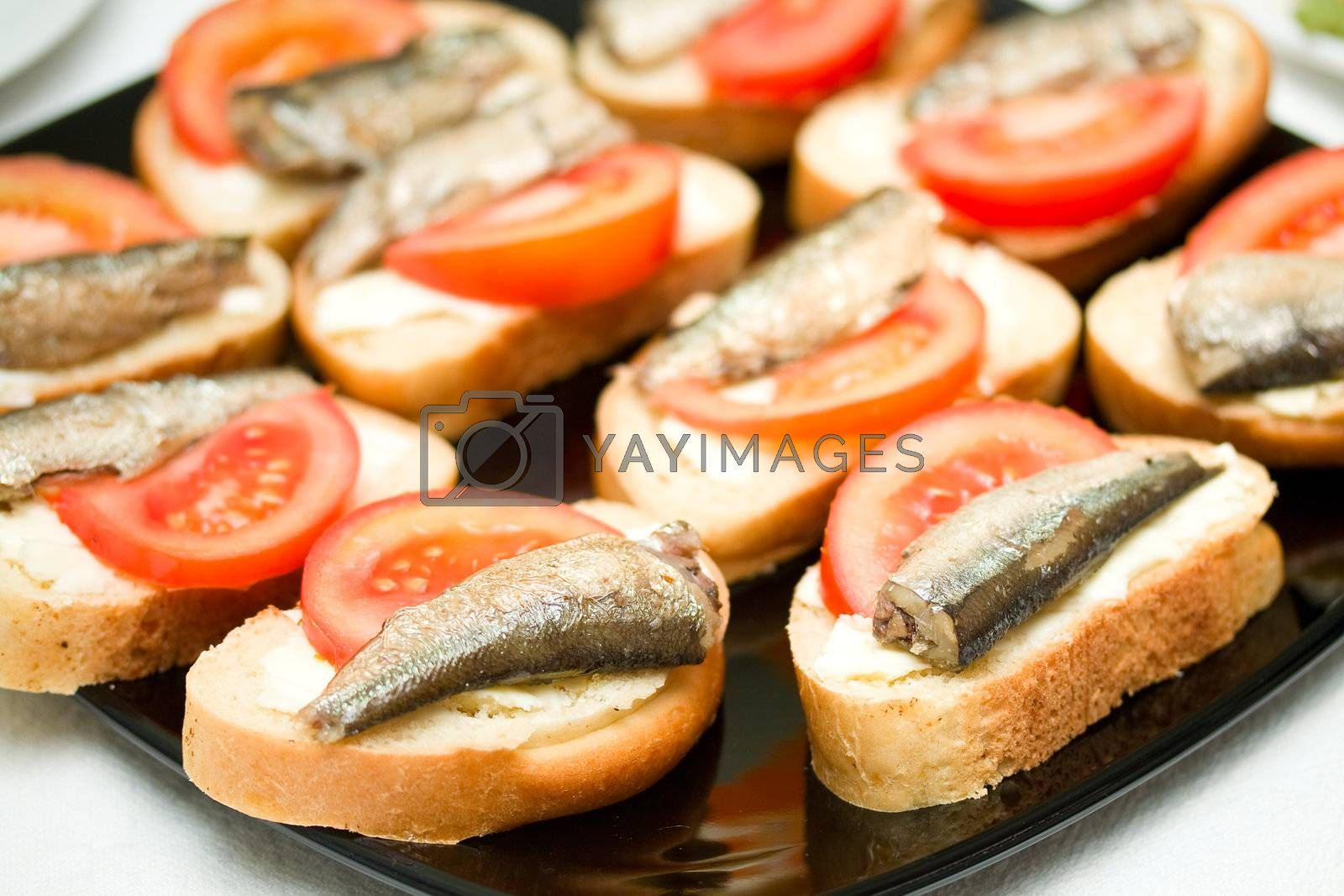 butters with sprat and tomato, on plate