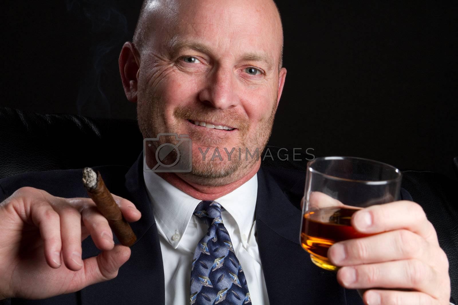 Man drinking and smoking cigar