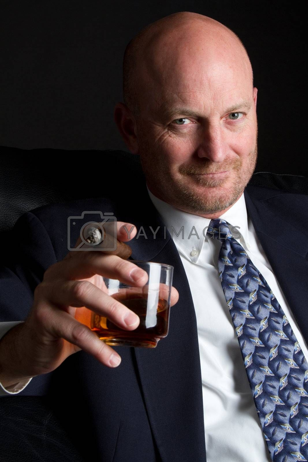 Man drinking alcohol smoking cigar