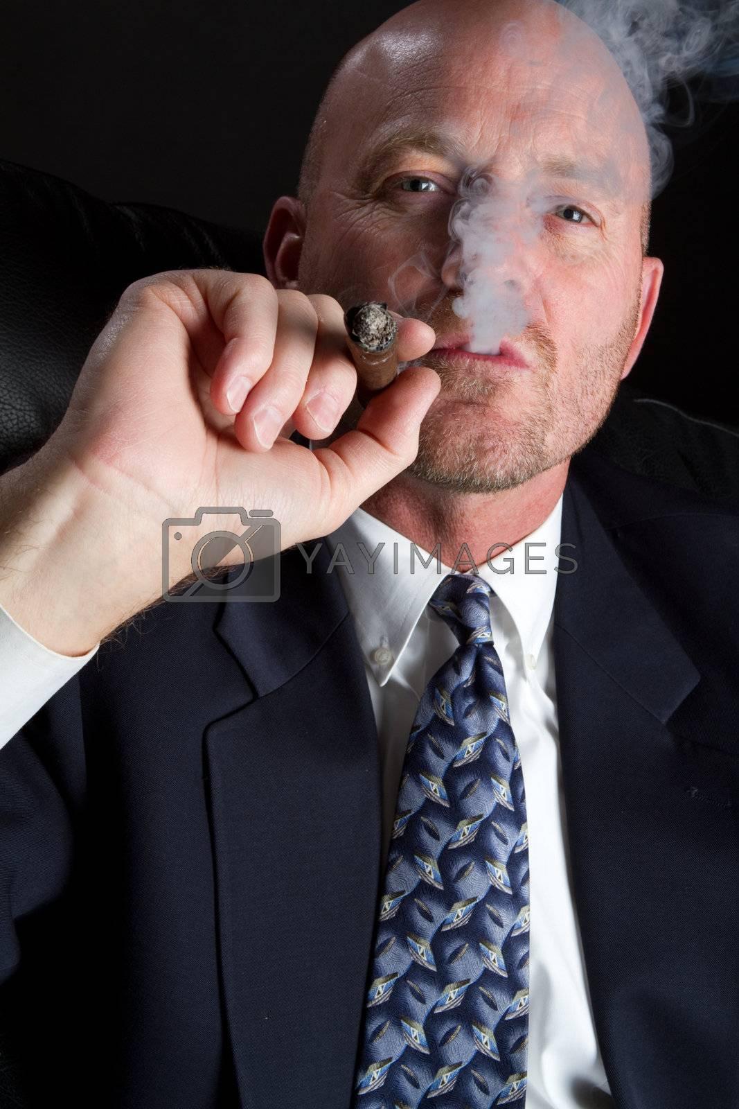 Business man smoking cigar