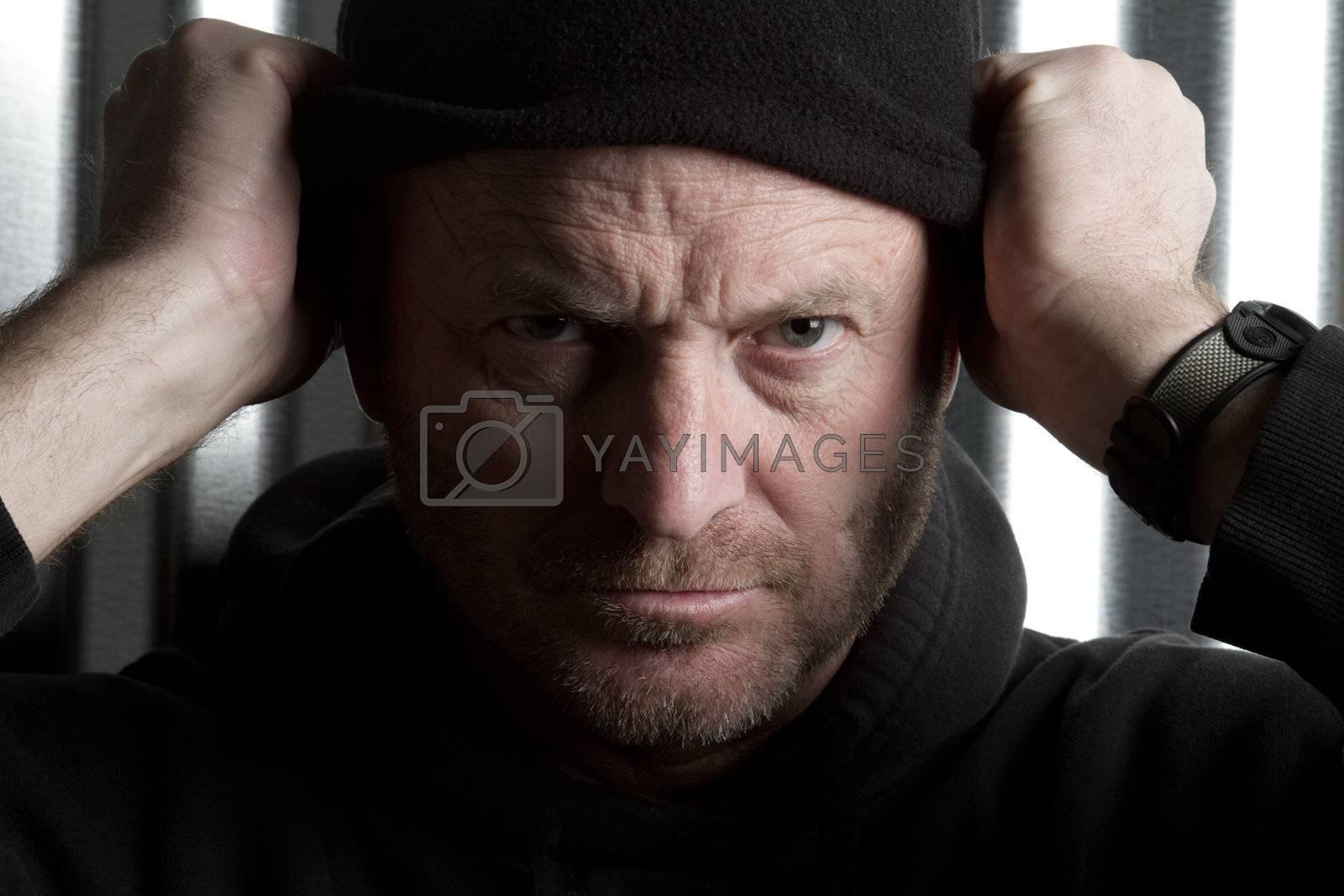Criminal man wearing black beanie