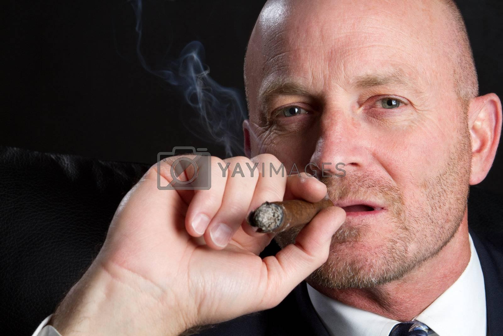 Bald man smoking cigar