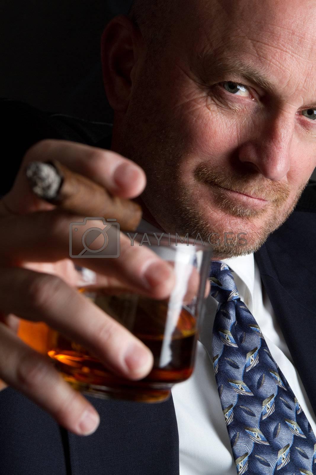 Businessman drinking and smoking cigar