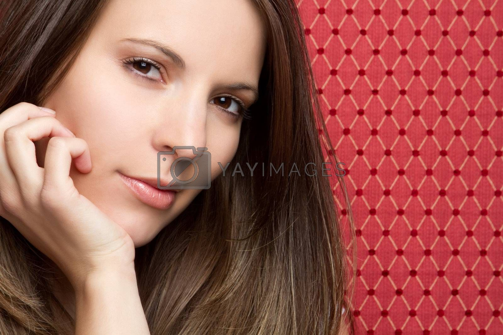Pretty young woman on red background