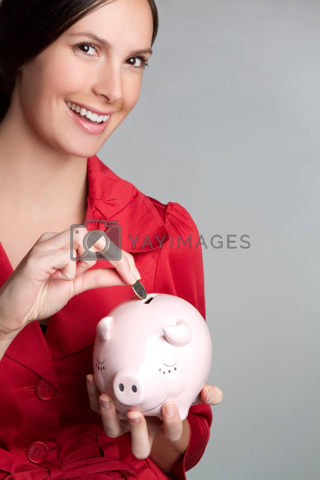 Woman saving money in piggy bank