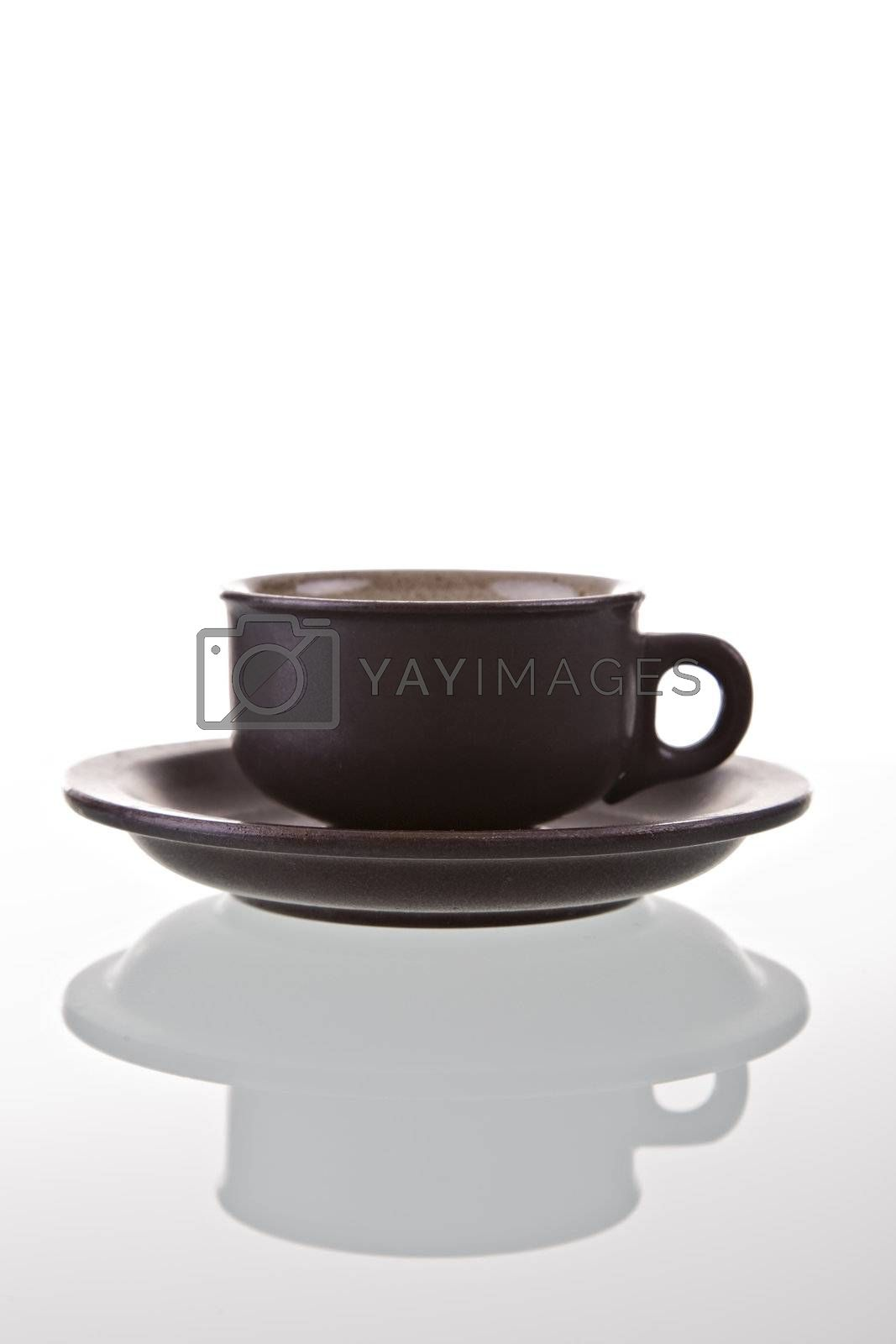 Coffee cup with reflection, isolated on white background.