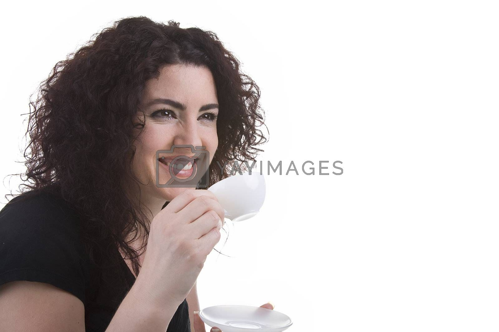 Beautiful brunette woman smiling, having an espresso. Studio shot. Isolated on white background.