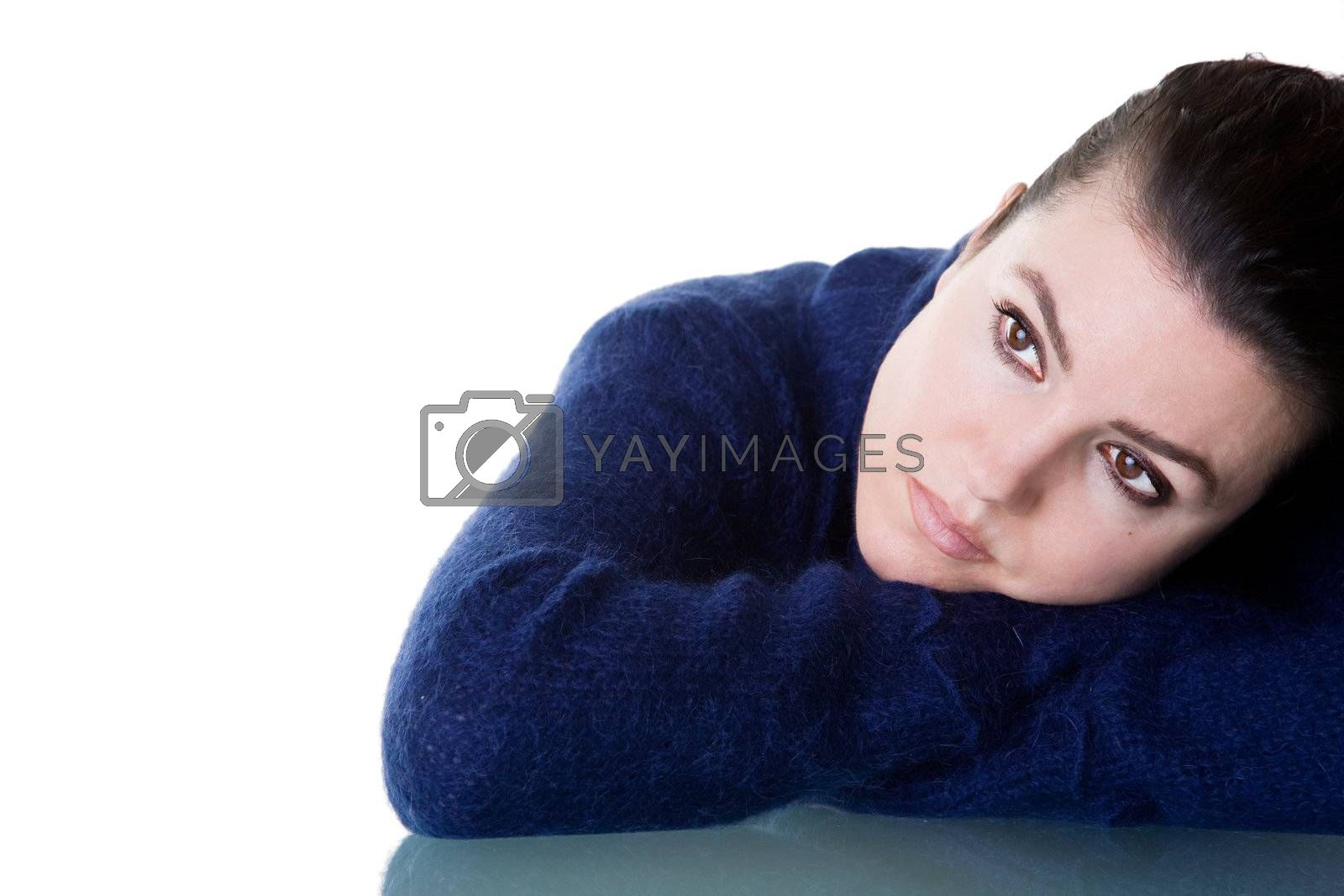 Beautiful woman with thoughtful look. Isolated on white background.