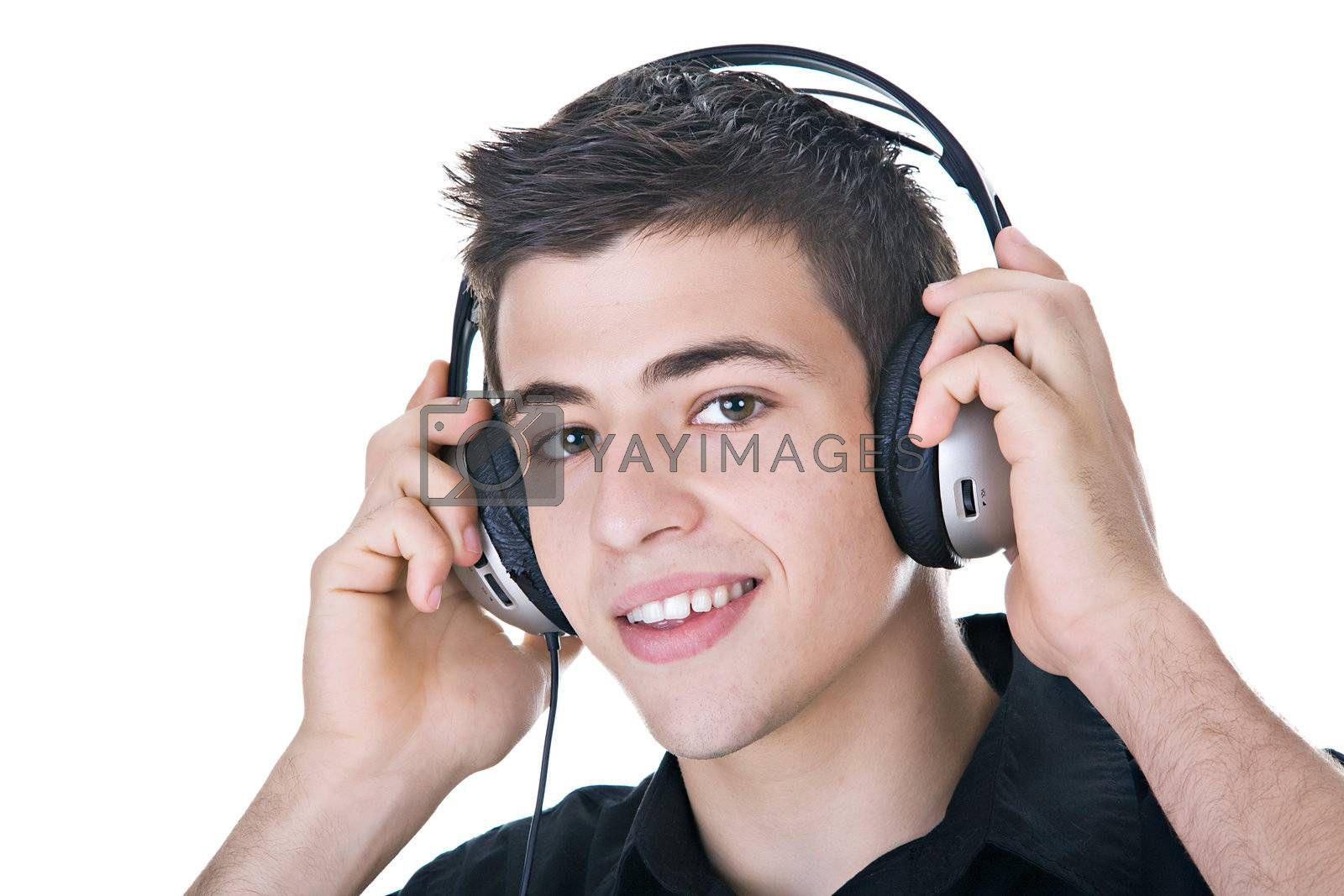 Young man, enjoying music with headphones. Isolated on white.