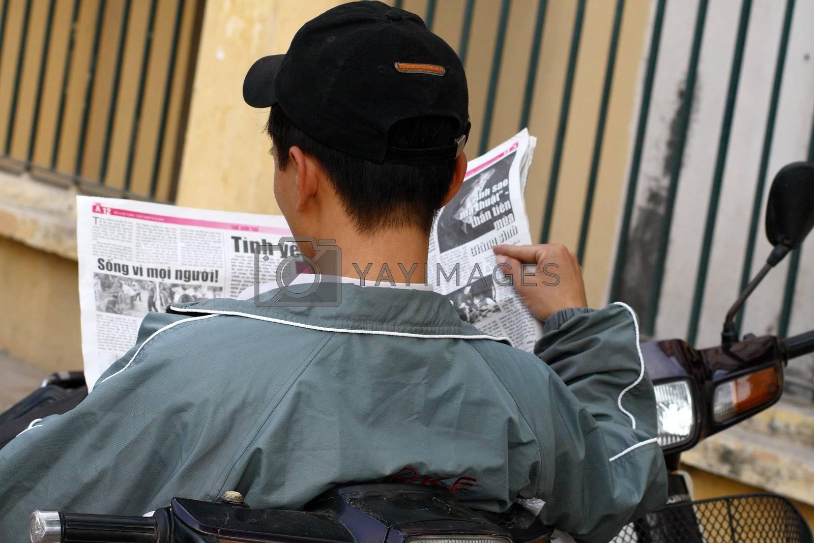 Asia man reading newspaper -Vietnam