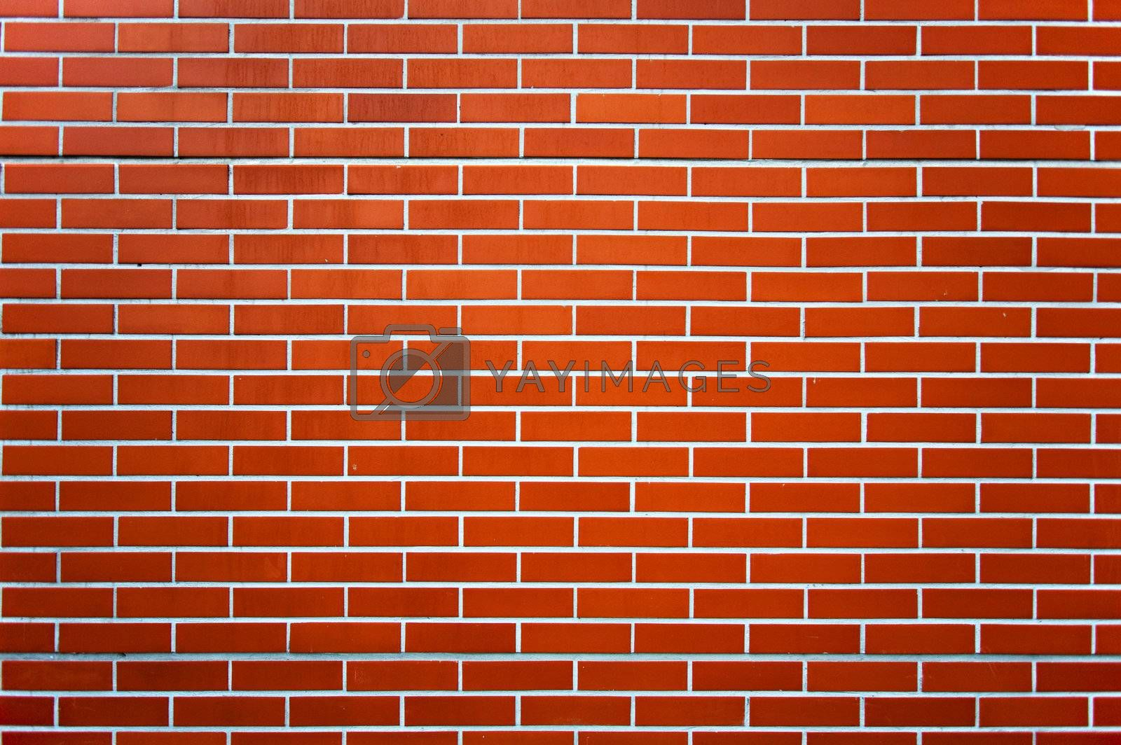 Photo of a red brick wall pattern.