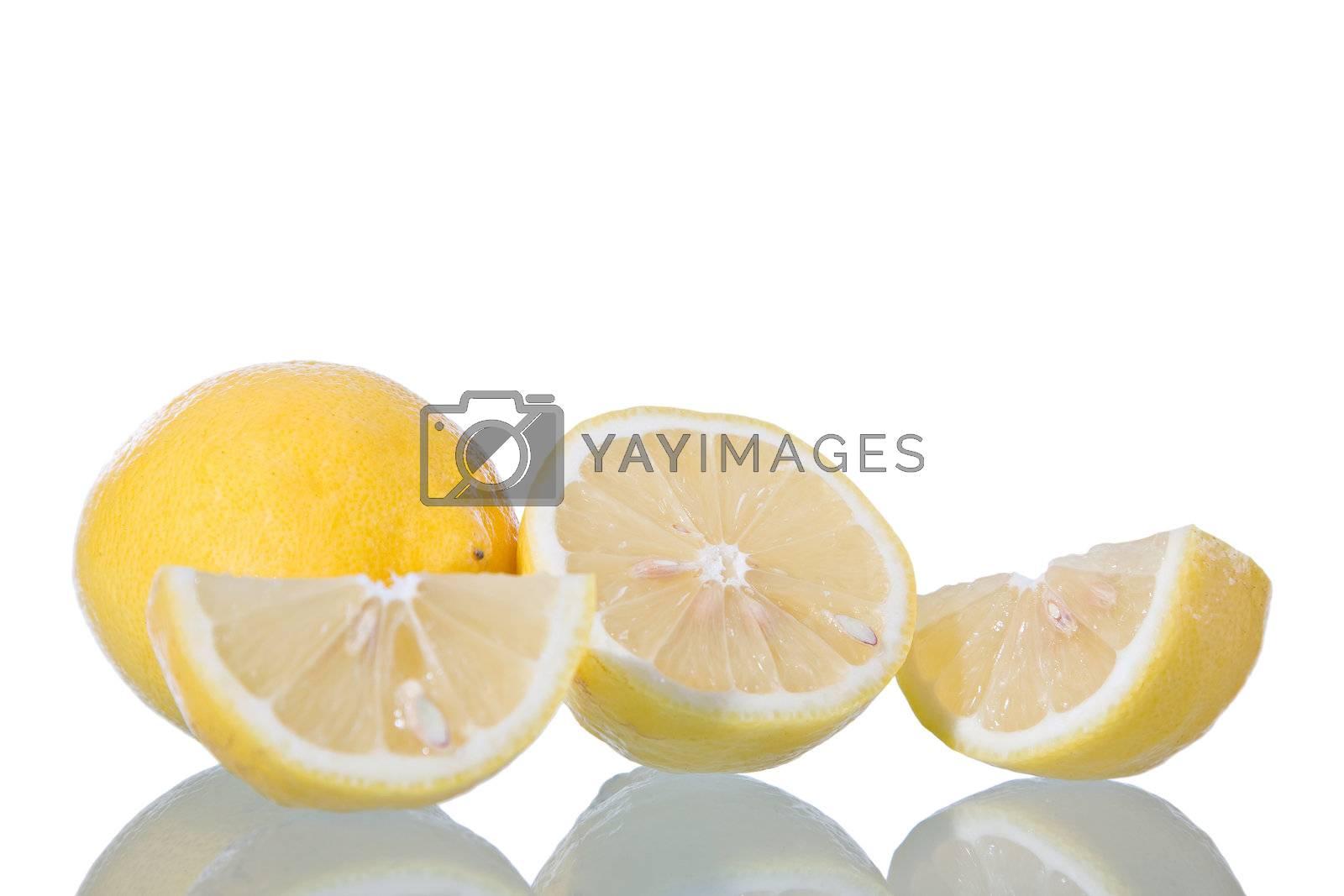 Sliced lemon, isolated on white background with reflection. Studio shot.