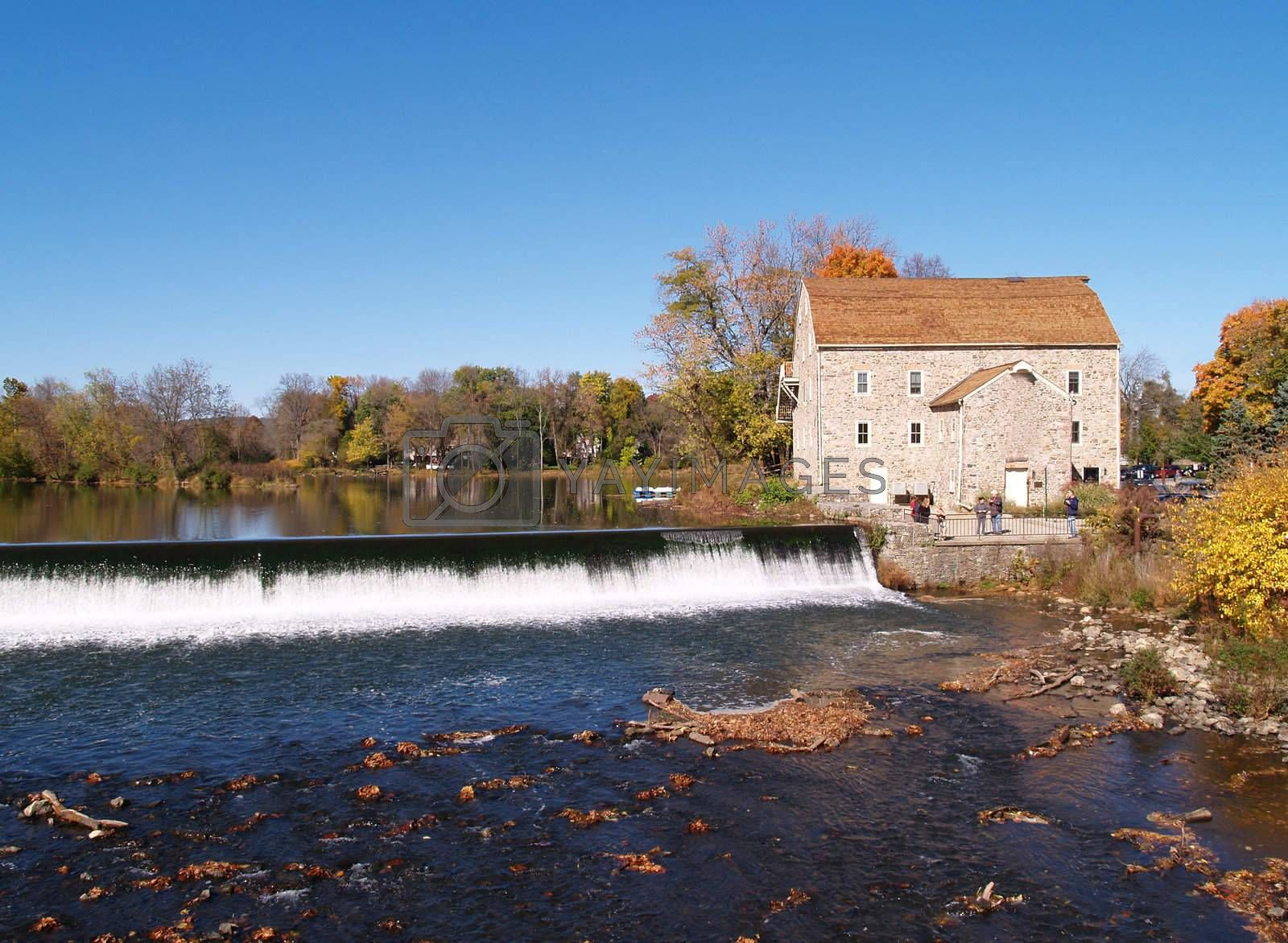 old stone mill in Clinton, New Jersey by a waterfall
