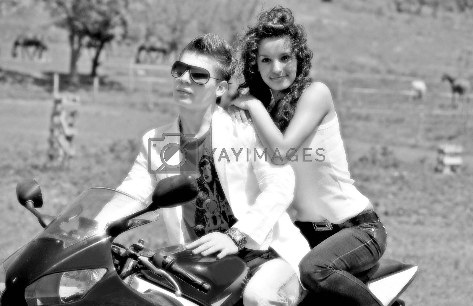 young couple in love riding a motorbike