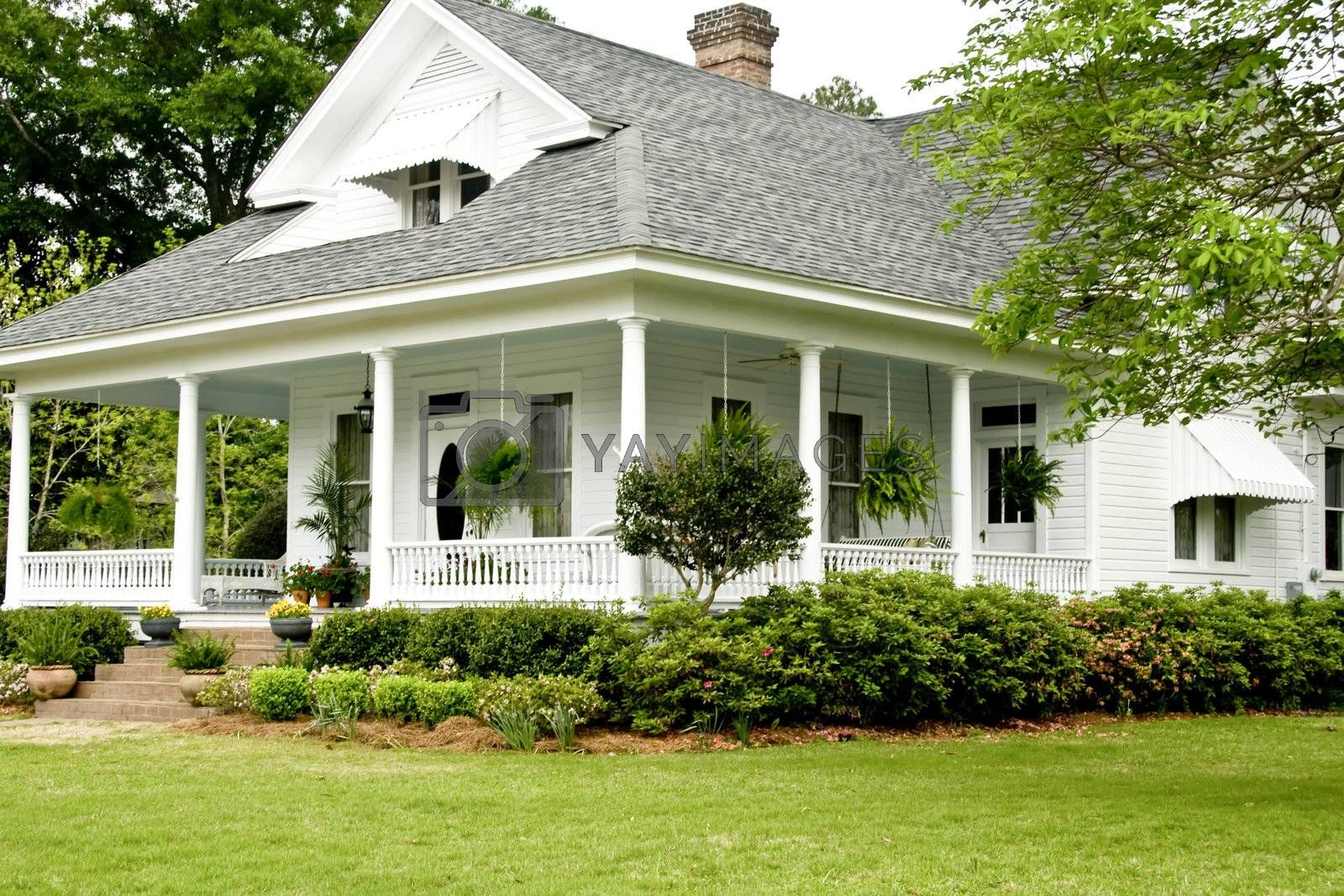Historic White home with wrap around porch.