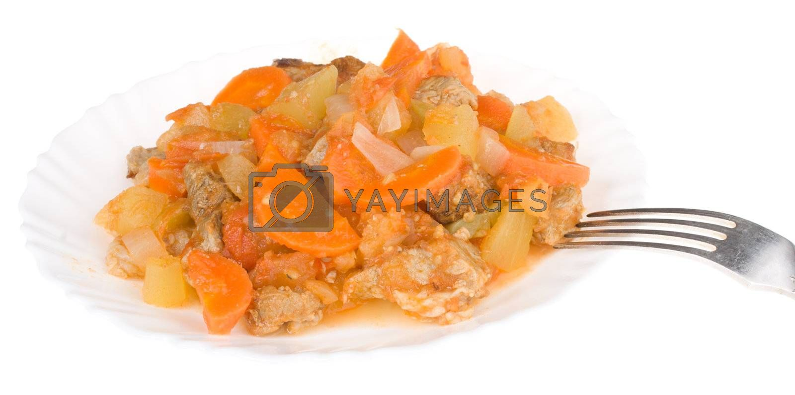 meat with vegetables on plate, isolated on white
