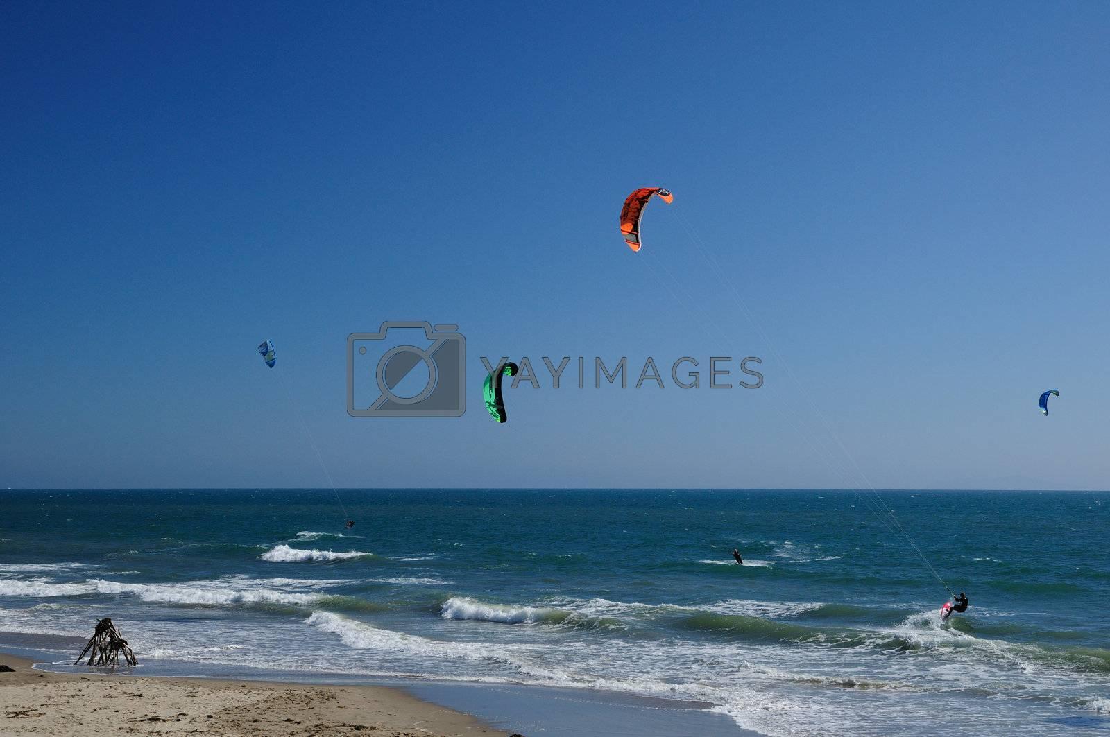 A driftwood teepee sets the scene for kitesurfing fun