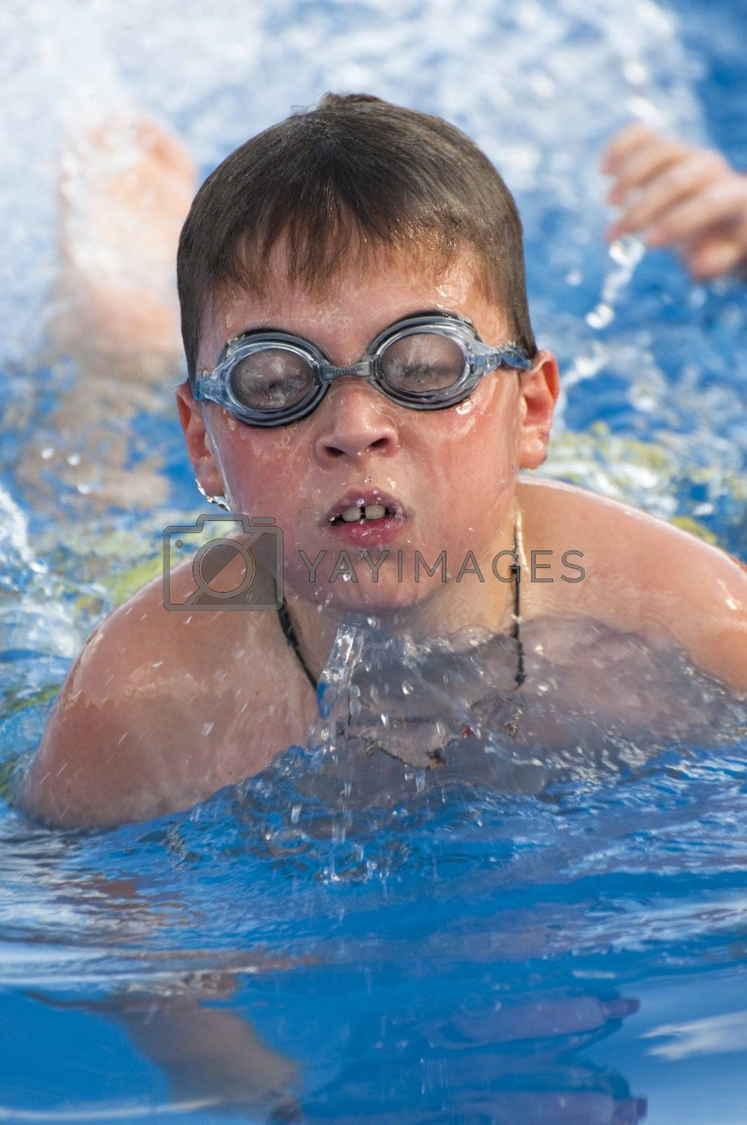 Picture of a boy on a swimming pool