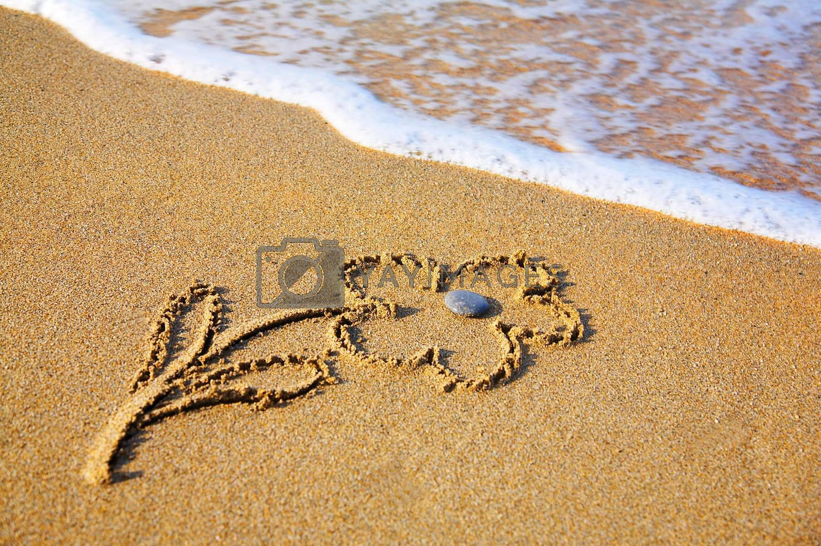 """Royalty free image of """"Flower"""" drawing at sand, with sea wave by DeusNoxious"""
