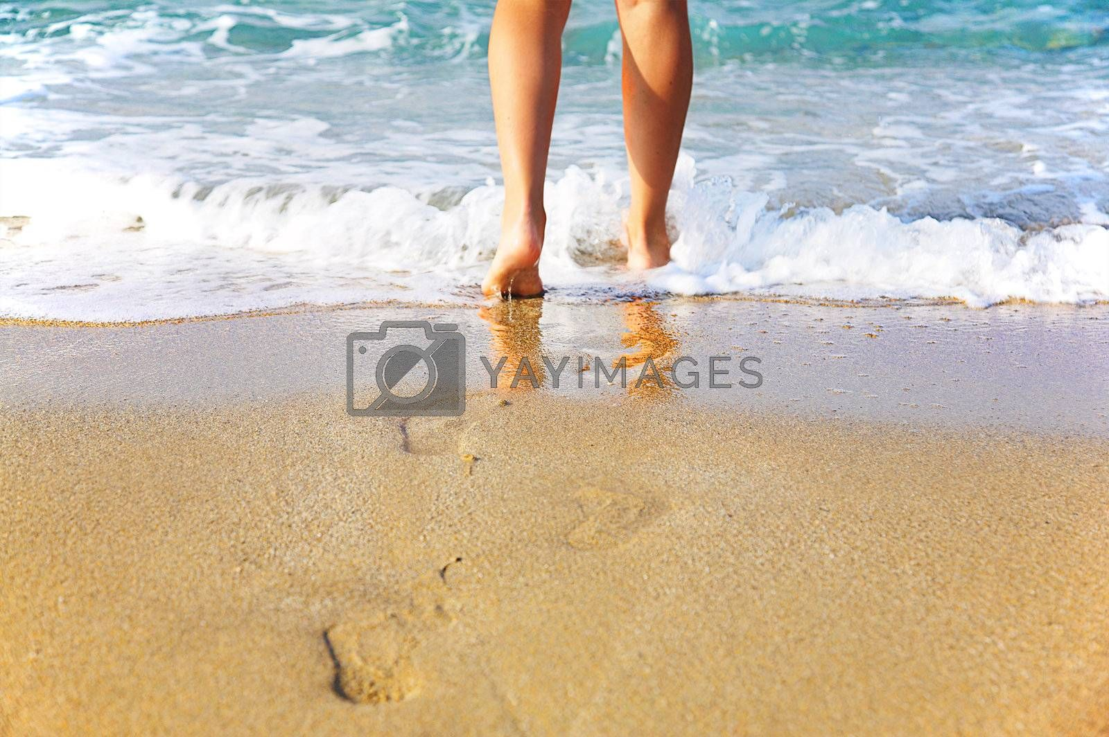 Woman's legs, going to sea
