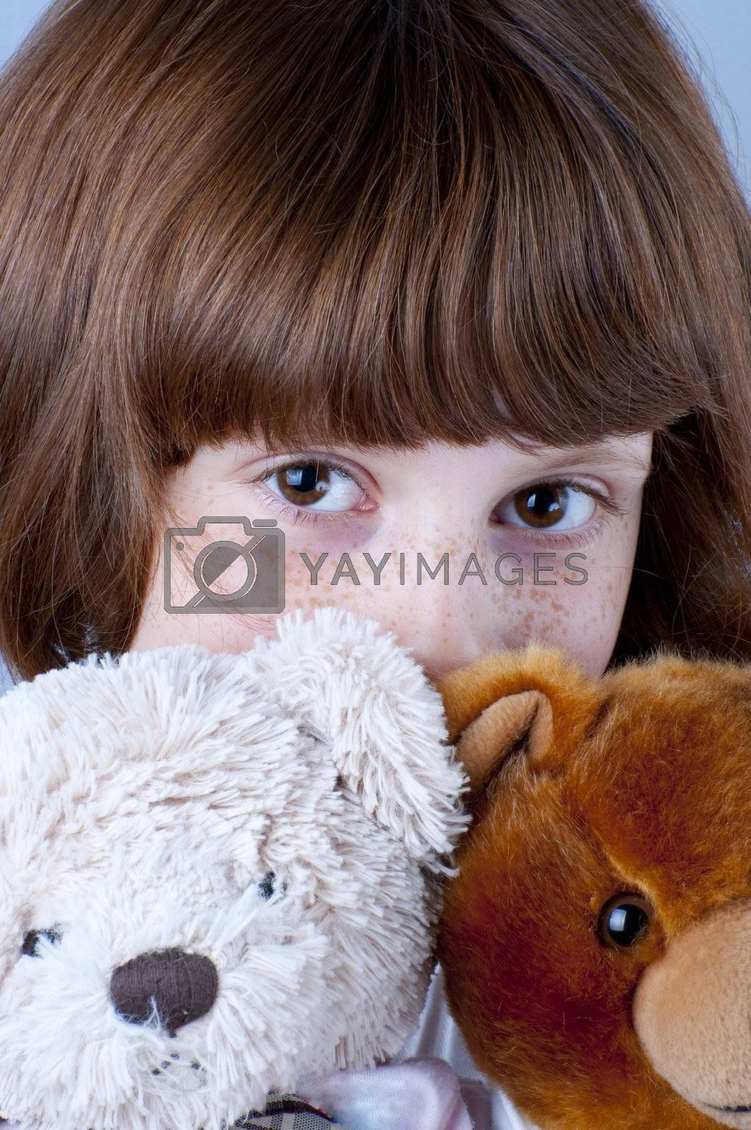 Picture of a young with freckles playing games.