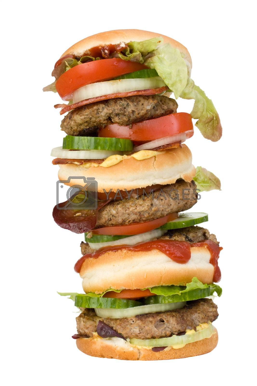 a home made quadruple hamburger isolated on white background