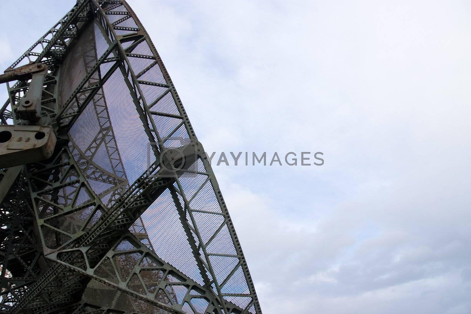 Portable military radar set against a white sky