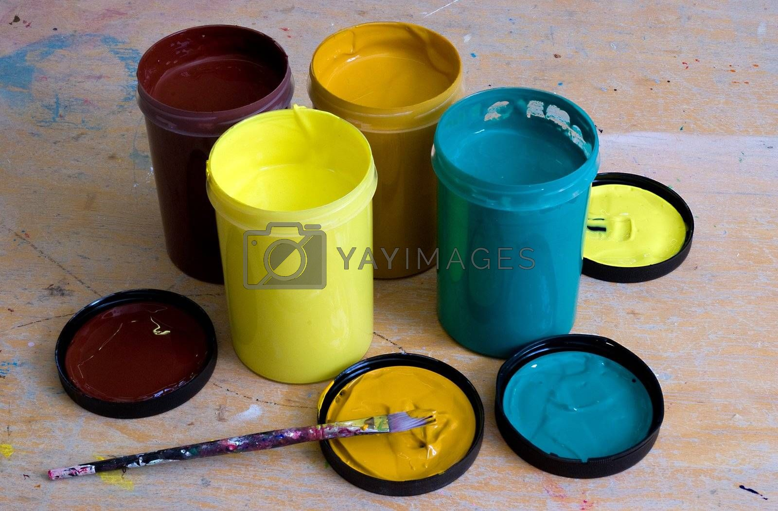 A group of 4 acrylic paint tubs on a work bench