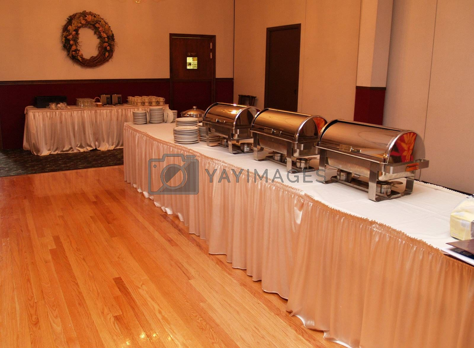cheffing dishes setup on a table in a banquet hall