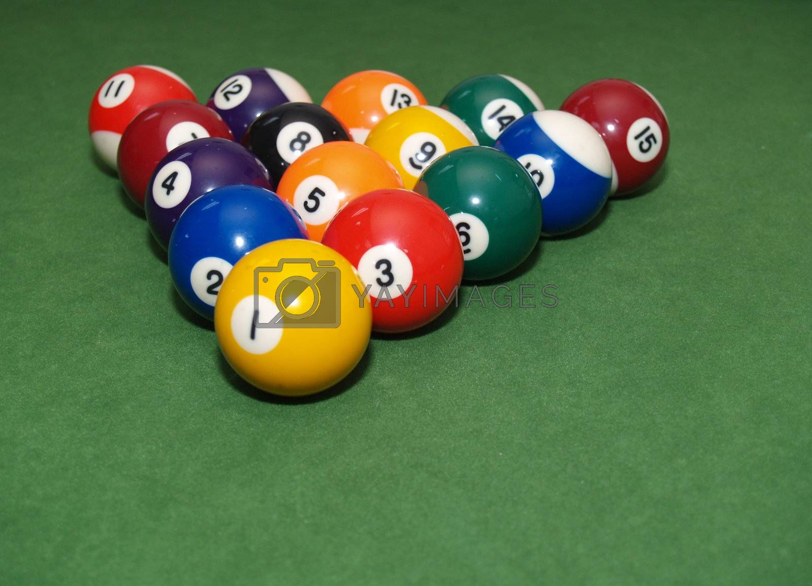 pool balls in a triangle shape on a green billiards table