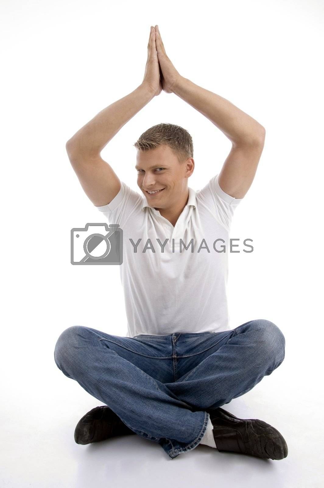 healthy guy in yoga position with white background