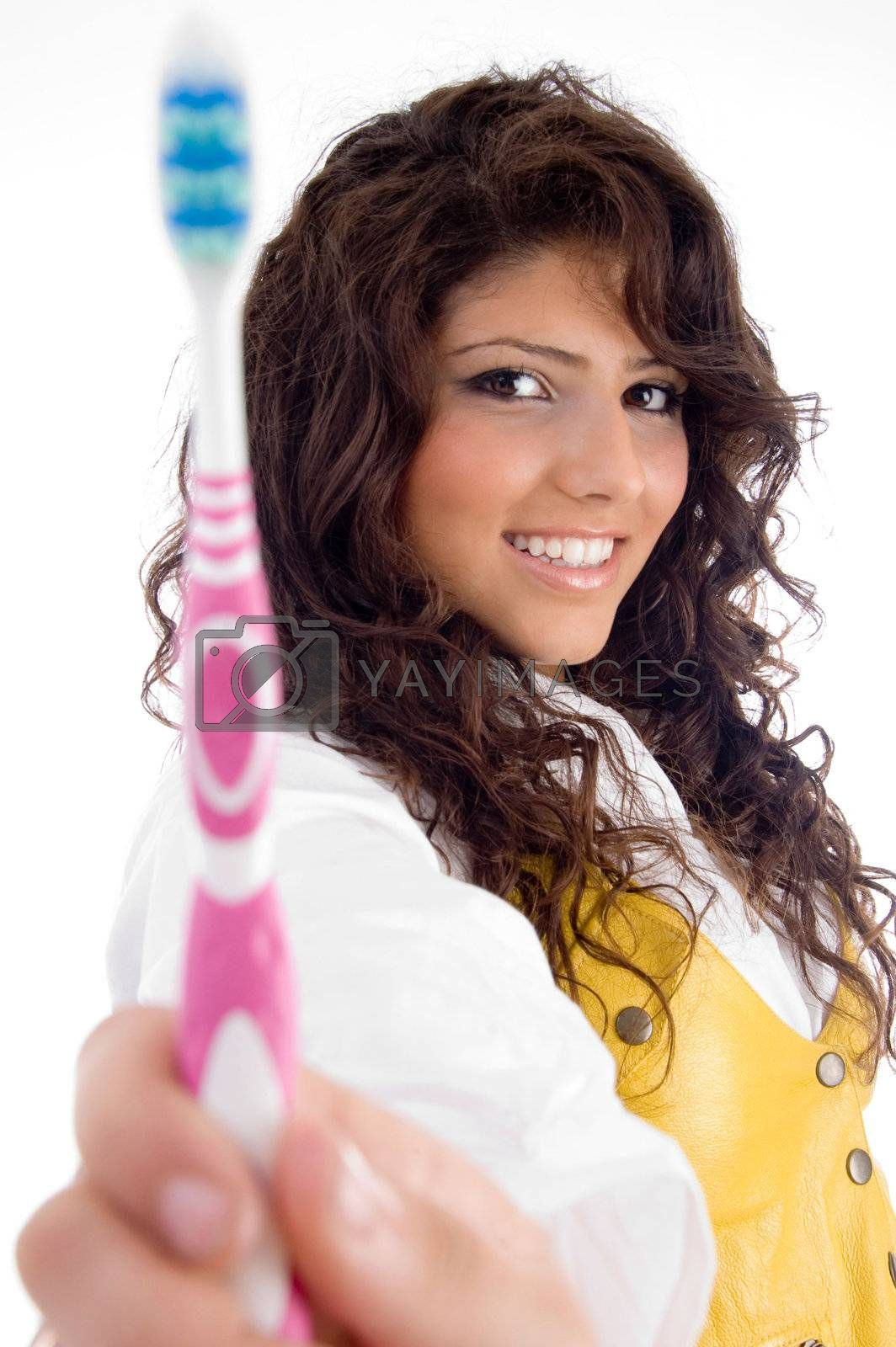 woman with tooth brush on an isolated white background