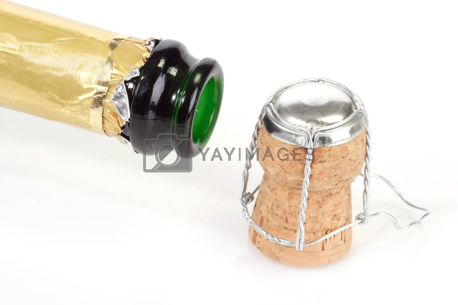 Open champagne bottle with cork on white background