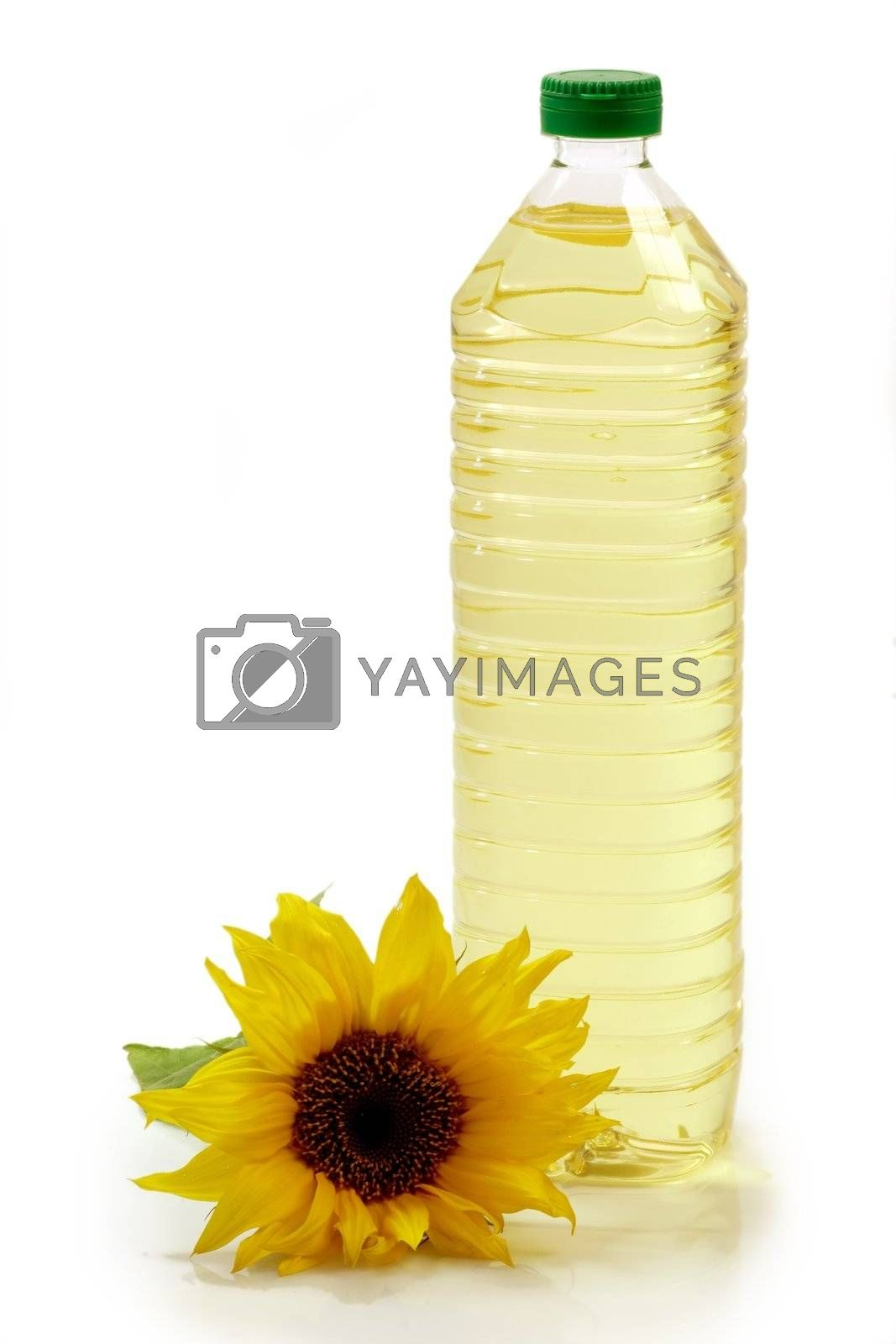 Cooking oil in a plastic bottle with sunflower on white background