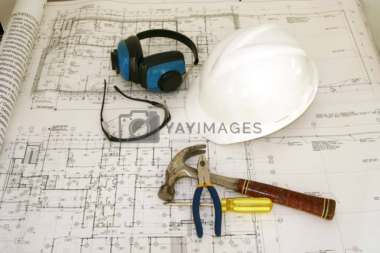 Construction worker equipments (hat, google, hammer and tools) and drawing