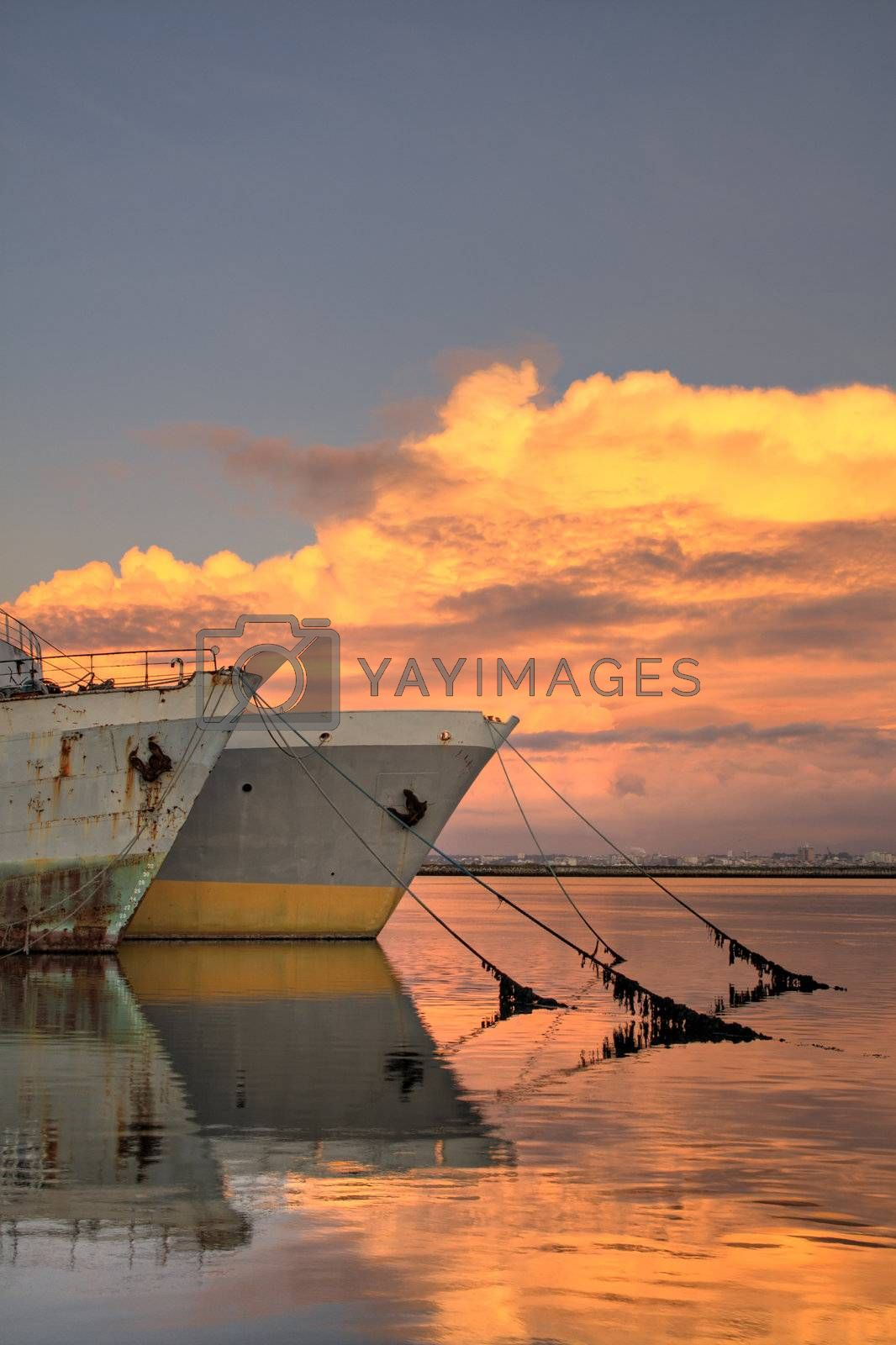 Old tankers in the sunset by PauloResende
