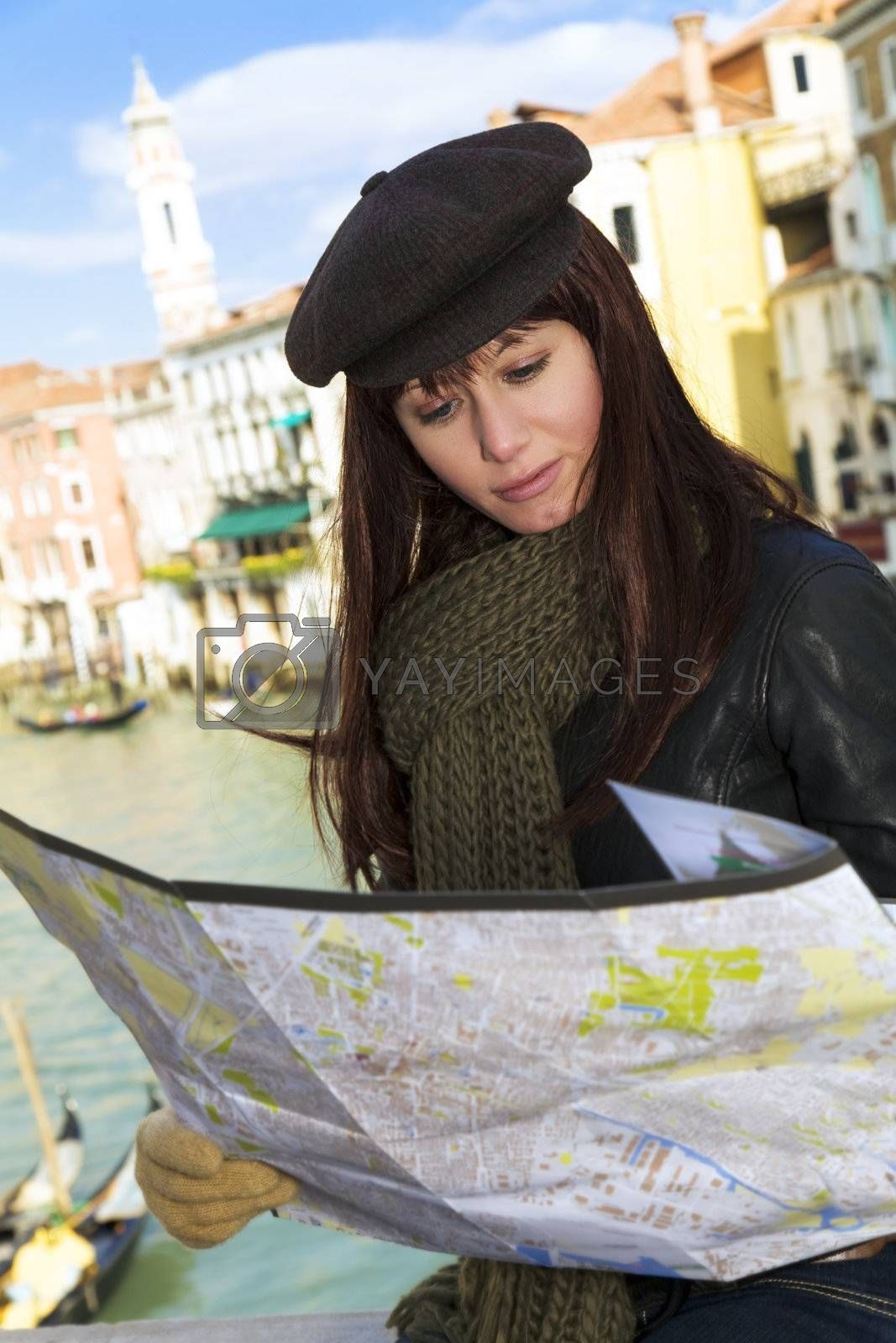 tourist attractions: woman reading a tourist map in Venice