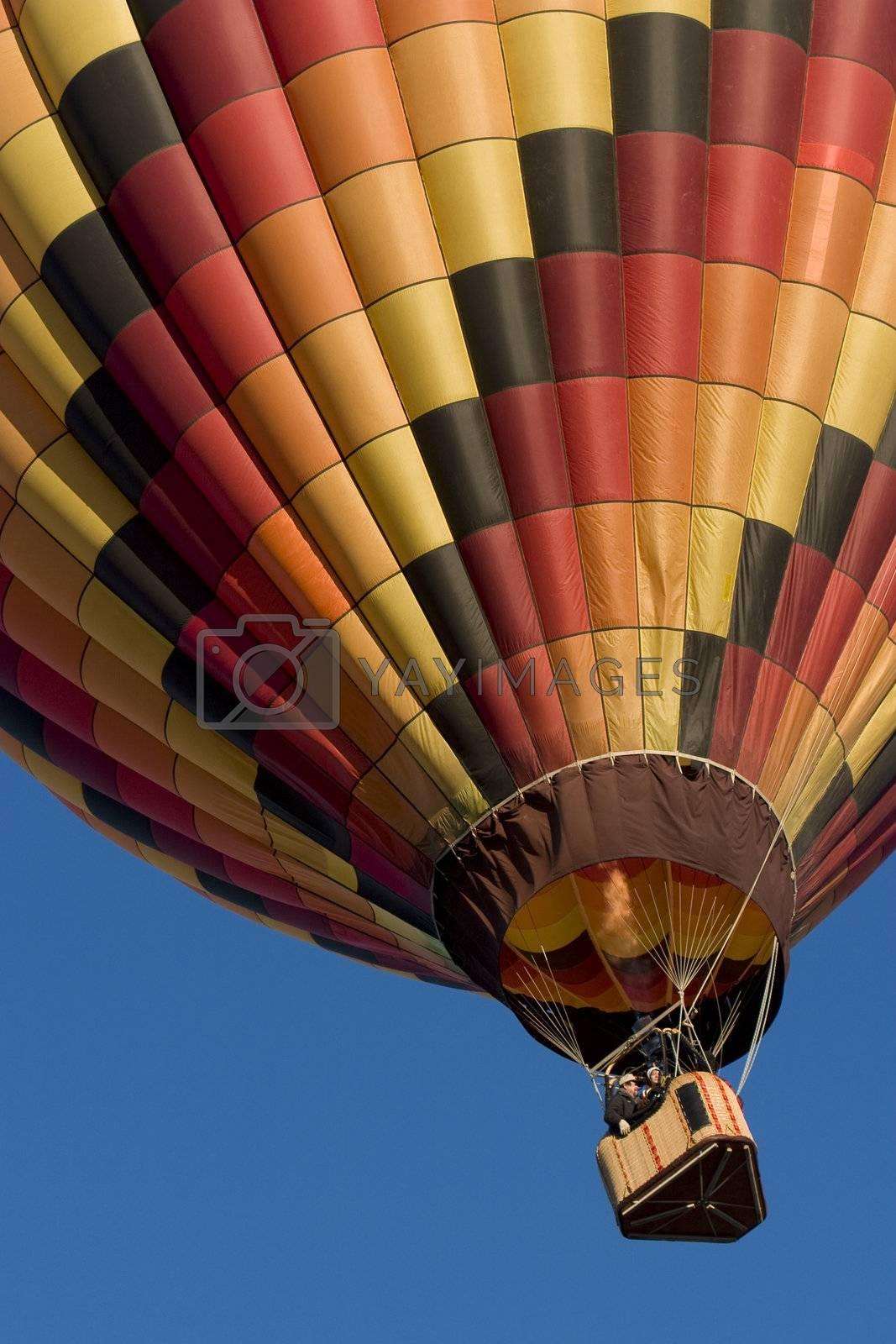multicolor hot air balloon rising at Arkansas Valley Festival, Rocky Ford, Colorado, November 4, 2007