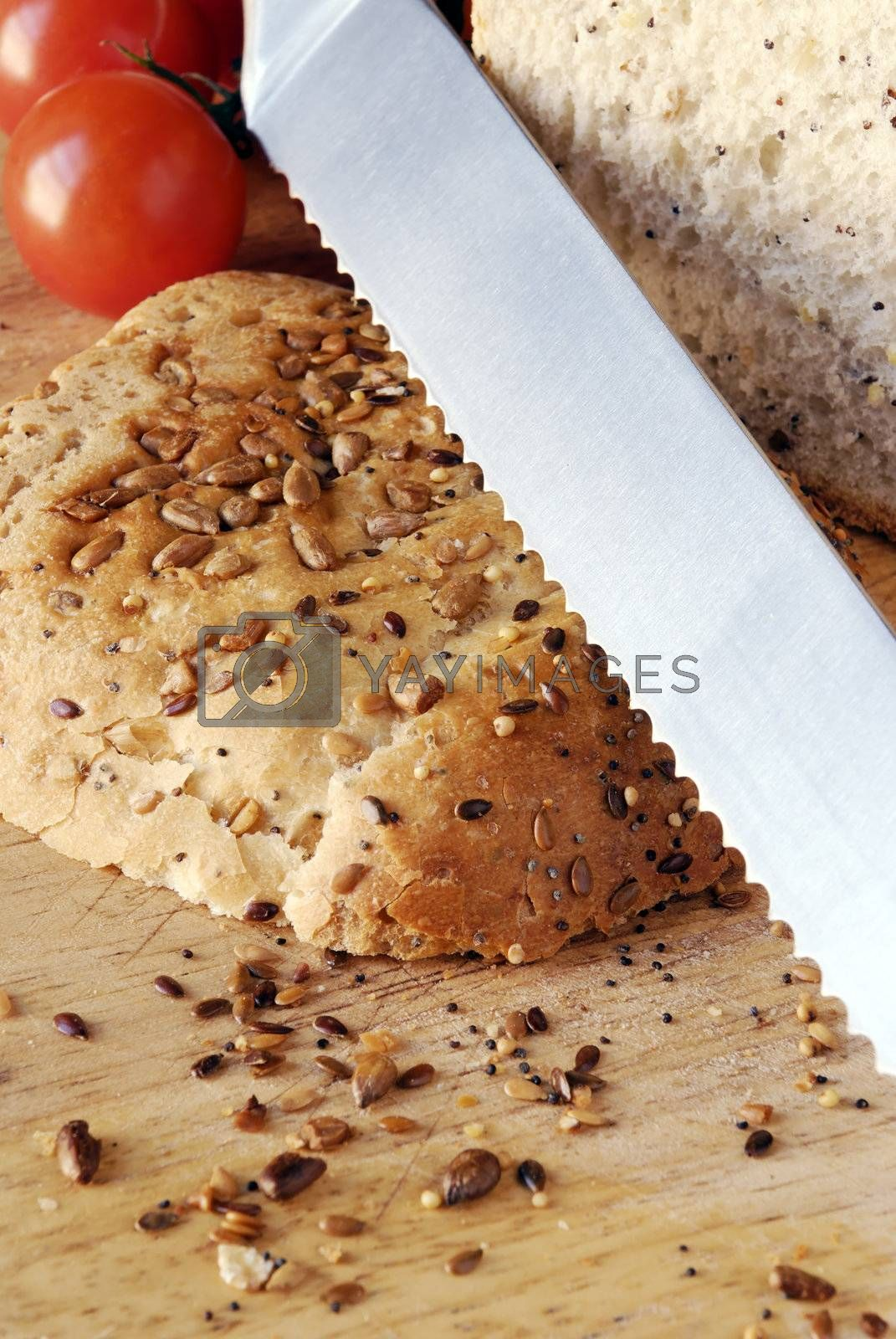 seeded bread on wooden board by massman