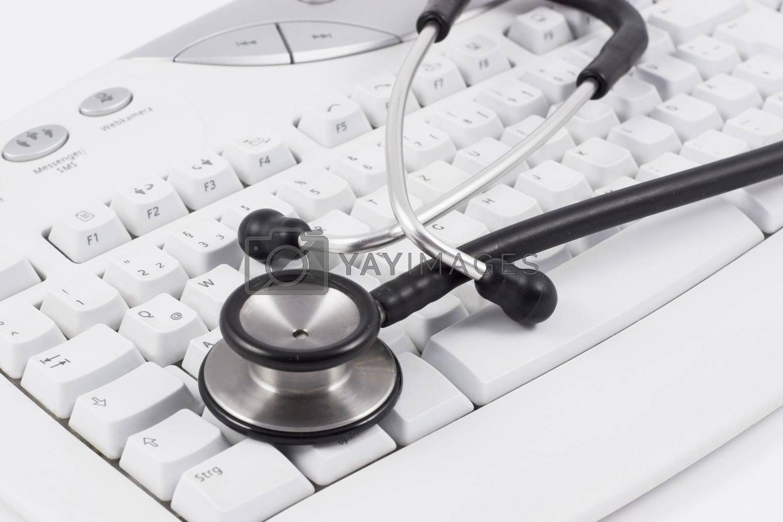 Stethoscope on white computer keyboard by ArtmannWitte