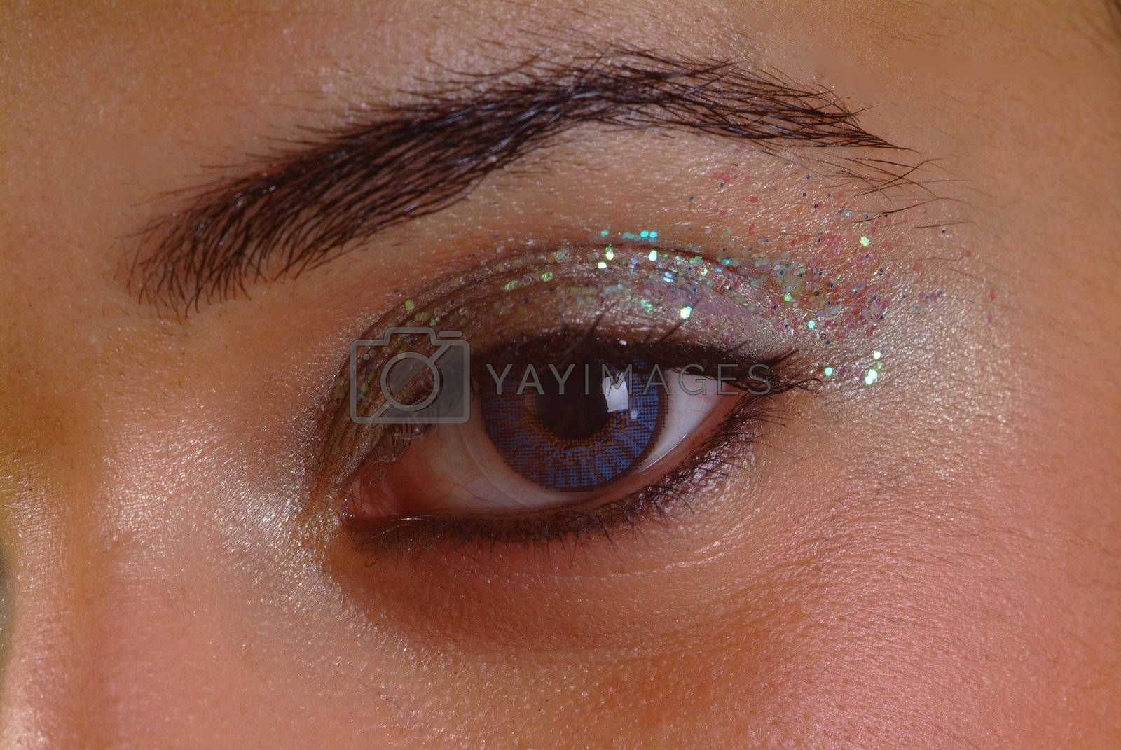 right eye open with glitter eyeshadow