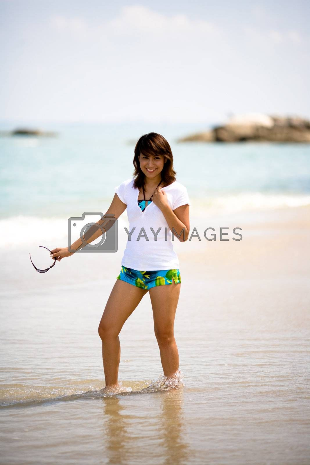 young woman having fun on the beach