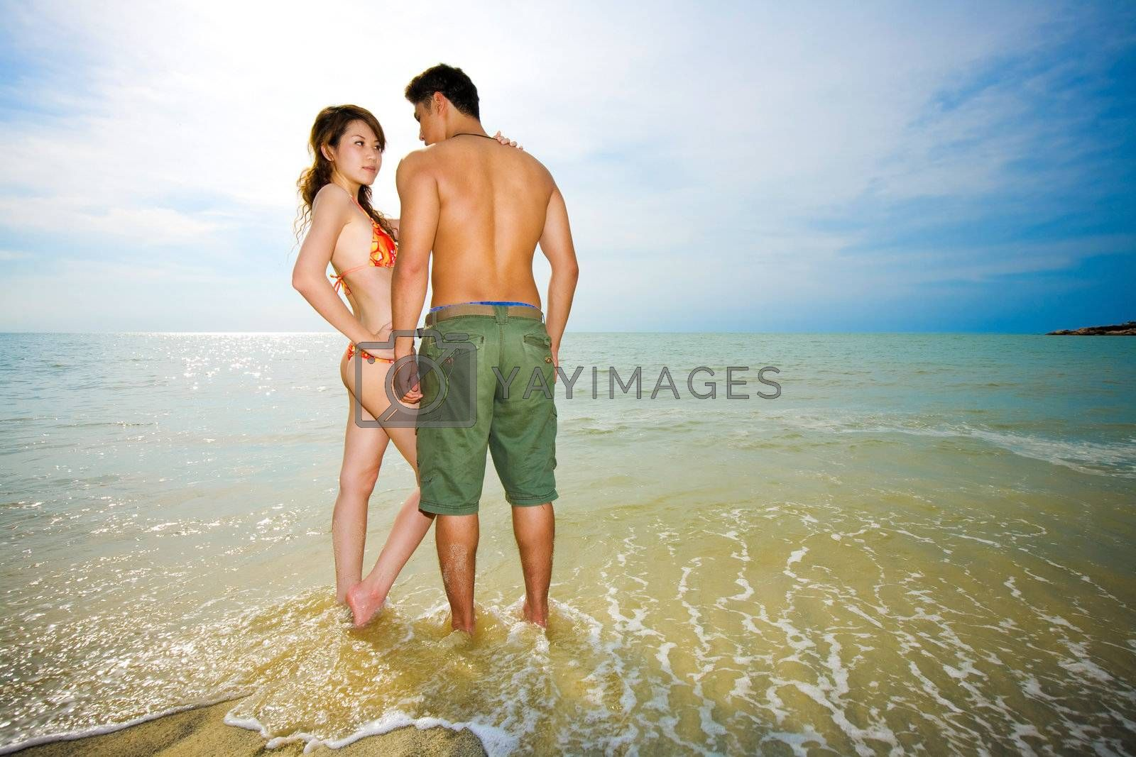 asian couple dating on the romantic beach