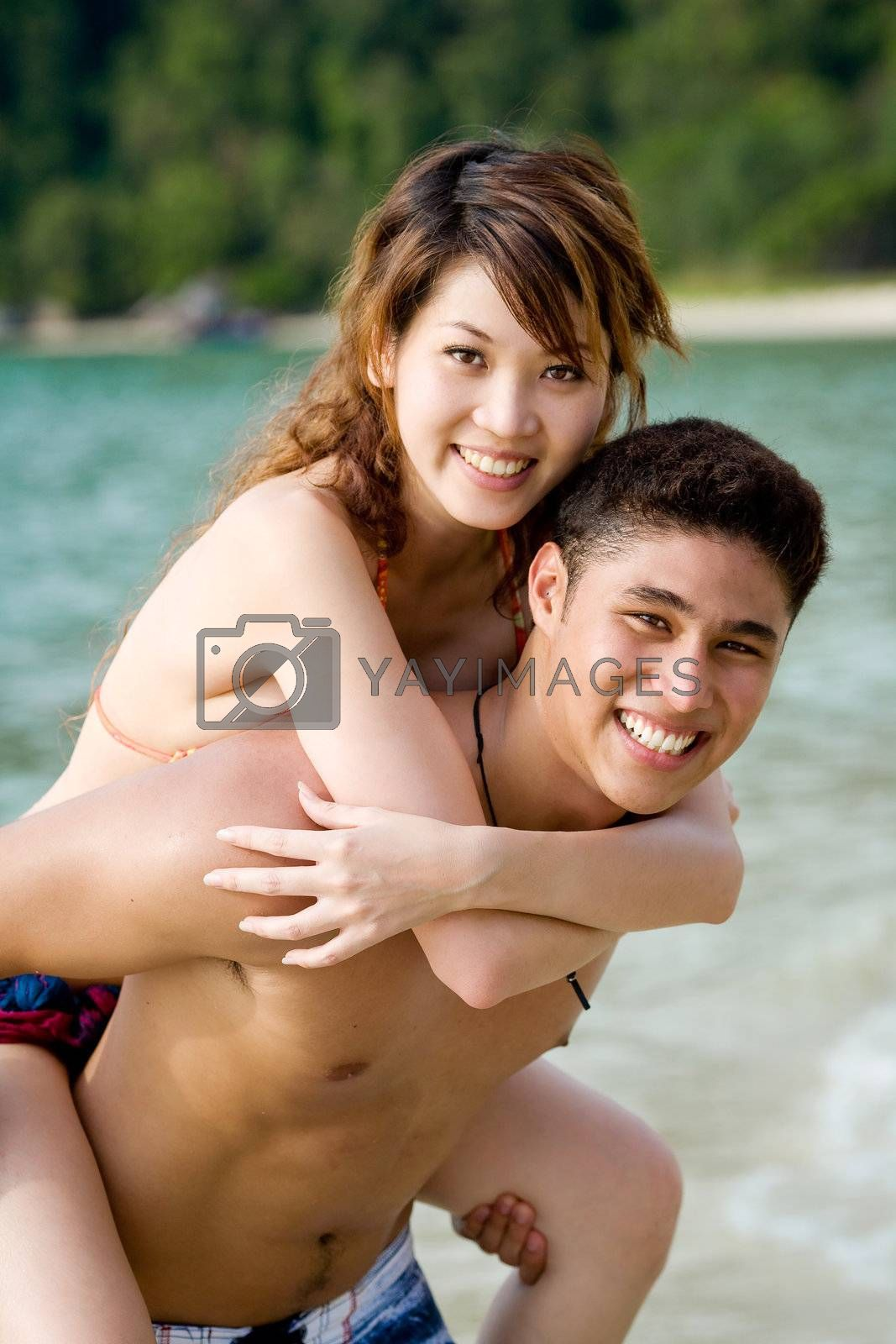 guy carrying piggyback of a girl by eyedear