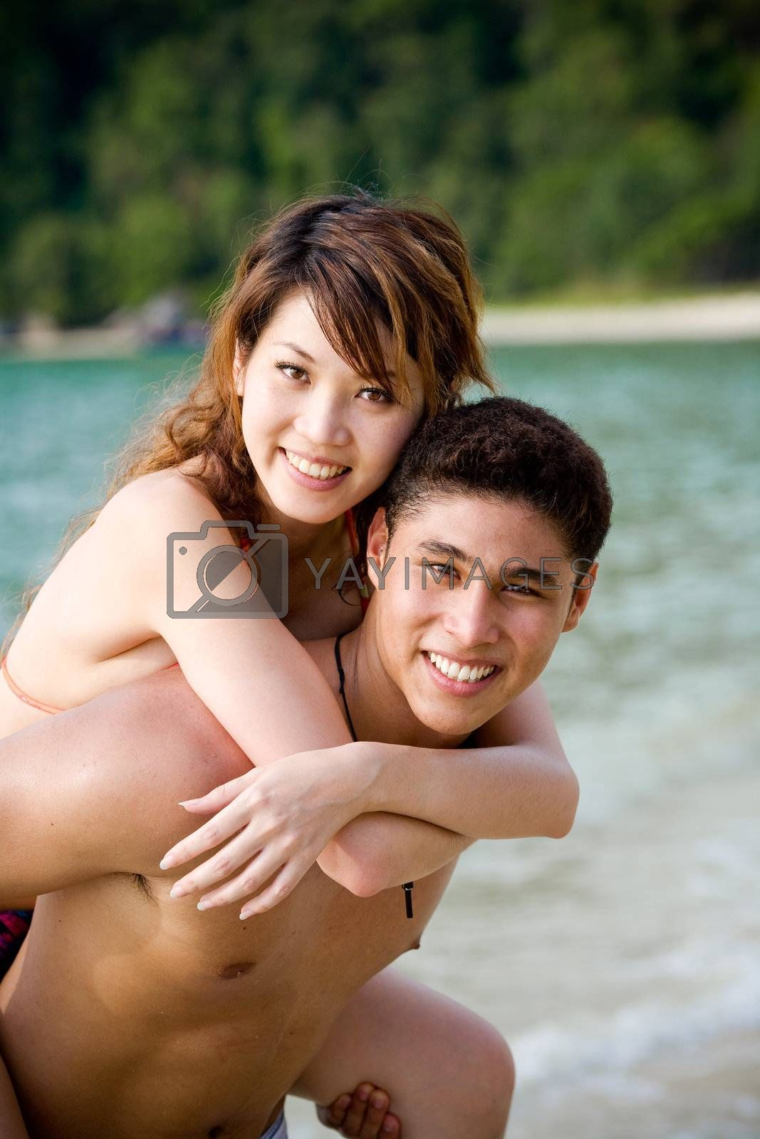 happy young couple by the beach having romantic time