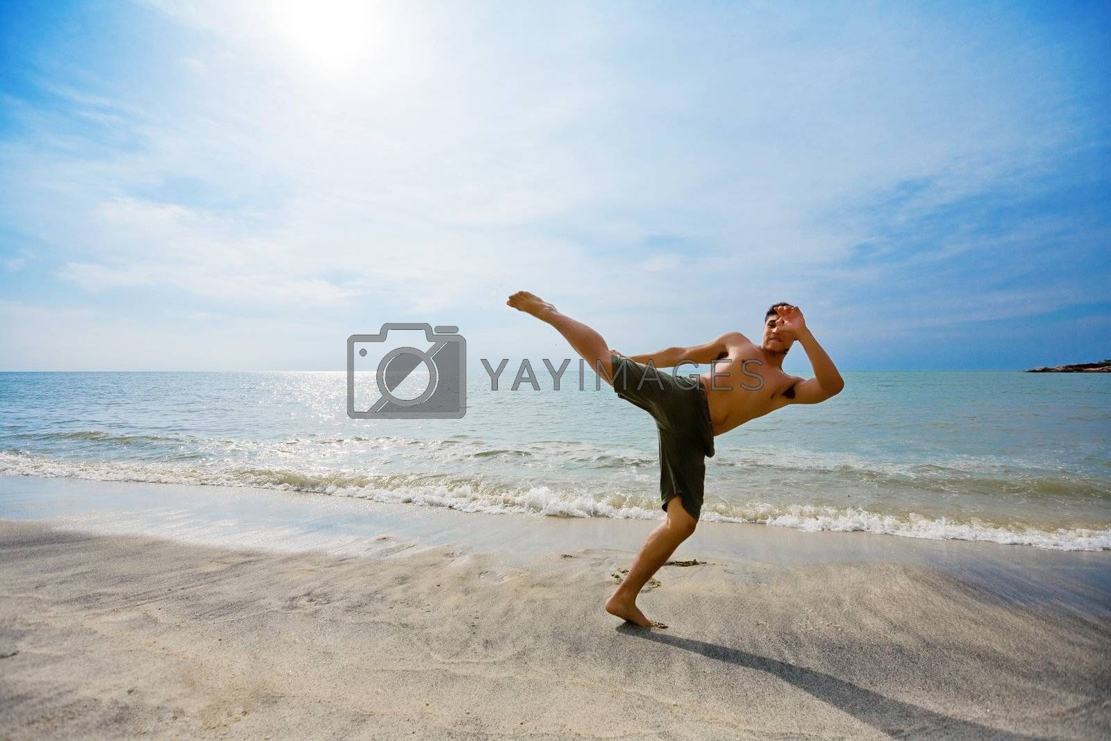 guy kick boxing by the beach by eyedear