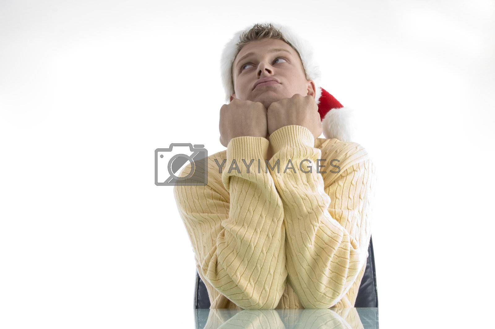 sad man wearing christmas hat with white background