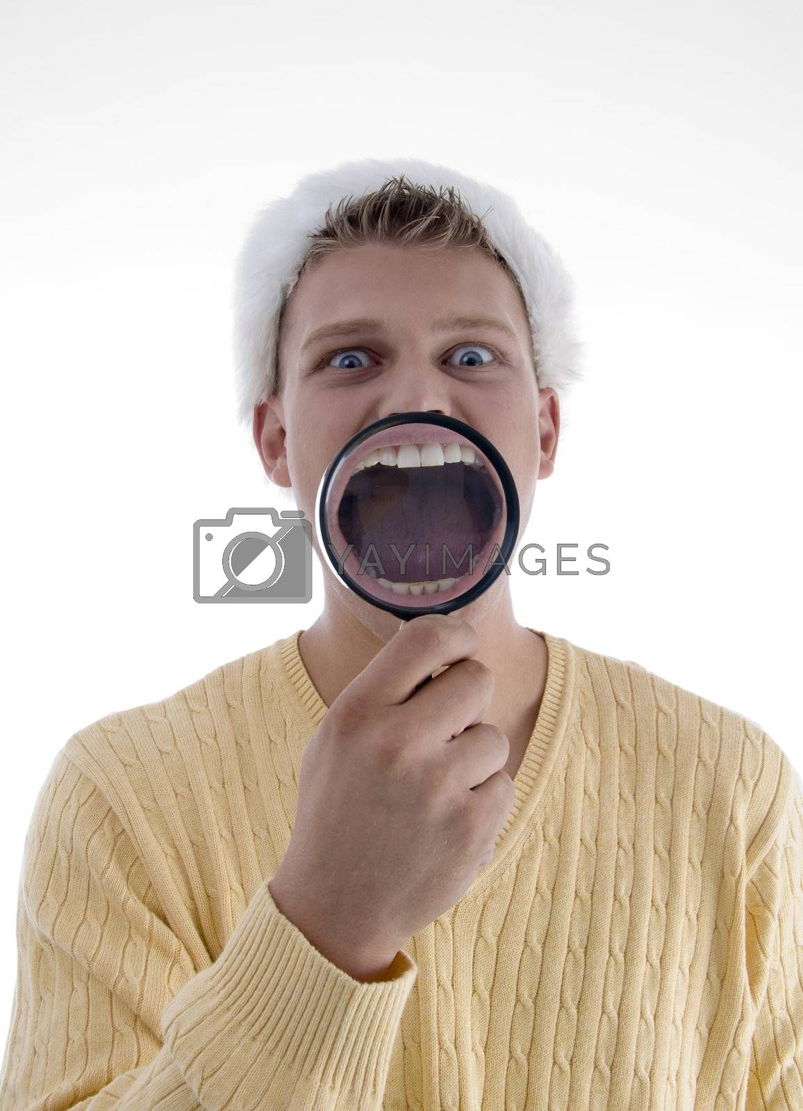 man weaing santa hat and showing teeth through lens on an isolated background
